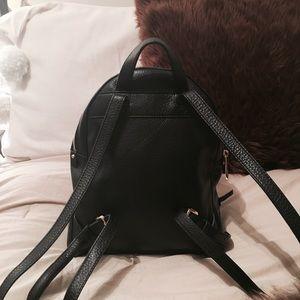 65e629b076e68b Michael Kors Bags - Michael Kors Rhea Medium Backpack